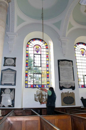 A Chandelier Above the South Aisle is Removed