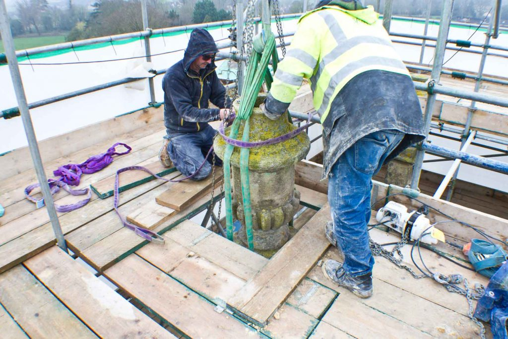 Lowering The Urn Through The Scaffolding Hole To The Pinnacle