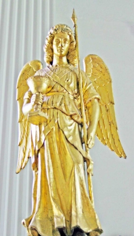 Angel on the South Post of the Reredos Holding a Spear and Chalice