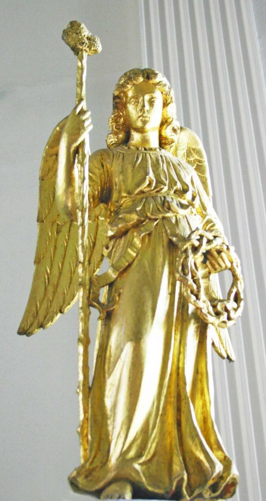 Angel on the North Post of the Reredos Holding a Staff and Crown of Thorns