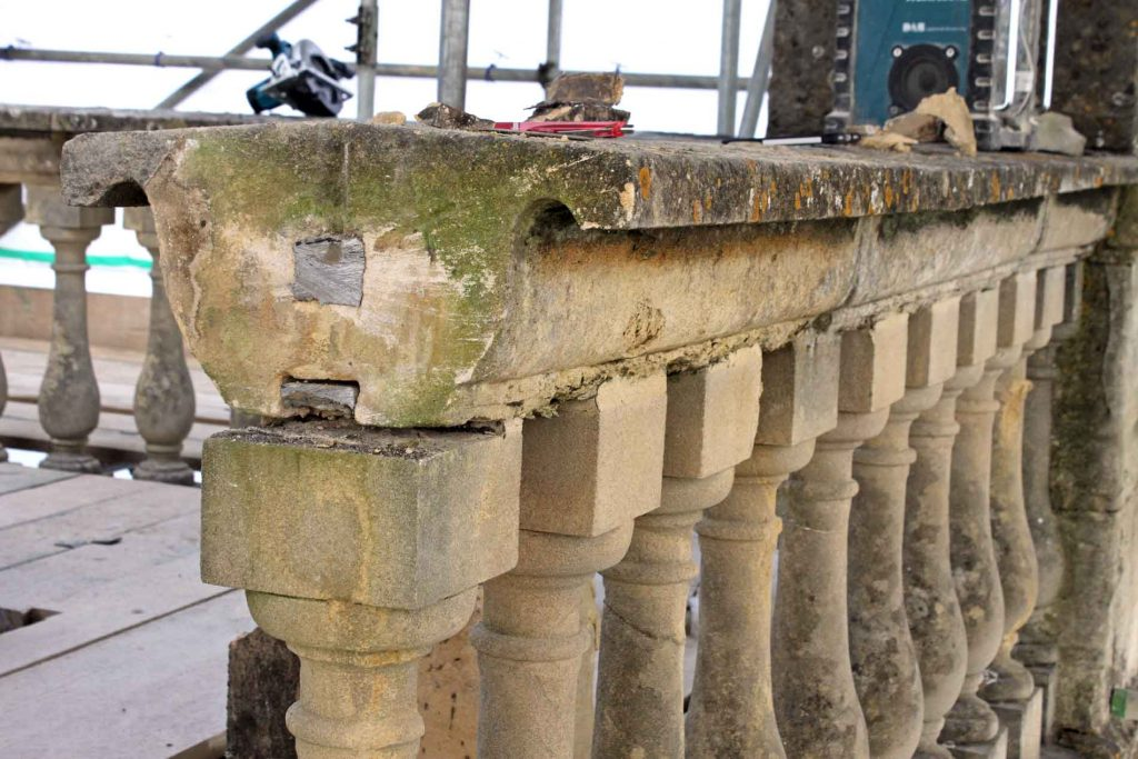 Upward Bowed Capping Stone Due to Poor Previous Repair